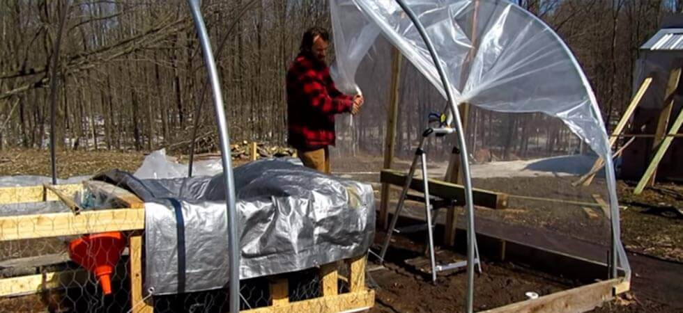 securing the plastic of the hoop house