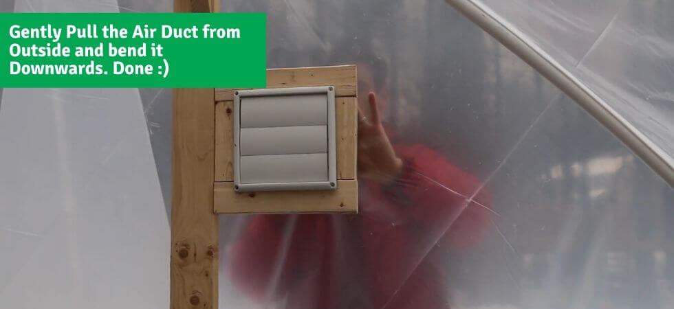 pulling the air duct and bending it downwards DIY Greenhouse Ventilation System